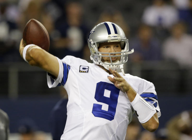 Dallas Cowboys quarterback Tony Romo (9) passes as he warms up before an NFL football game against the Washington Redskins, Sunday, Oct. 13, 2013, in Arlington, Texas. (AP Photo/LM Otero)