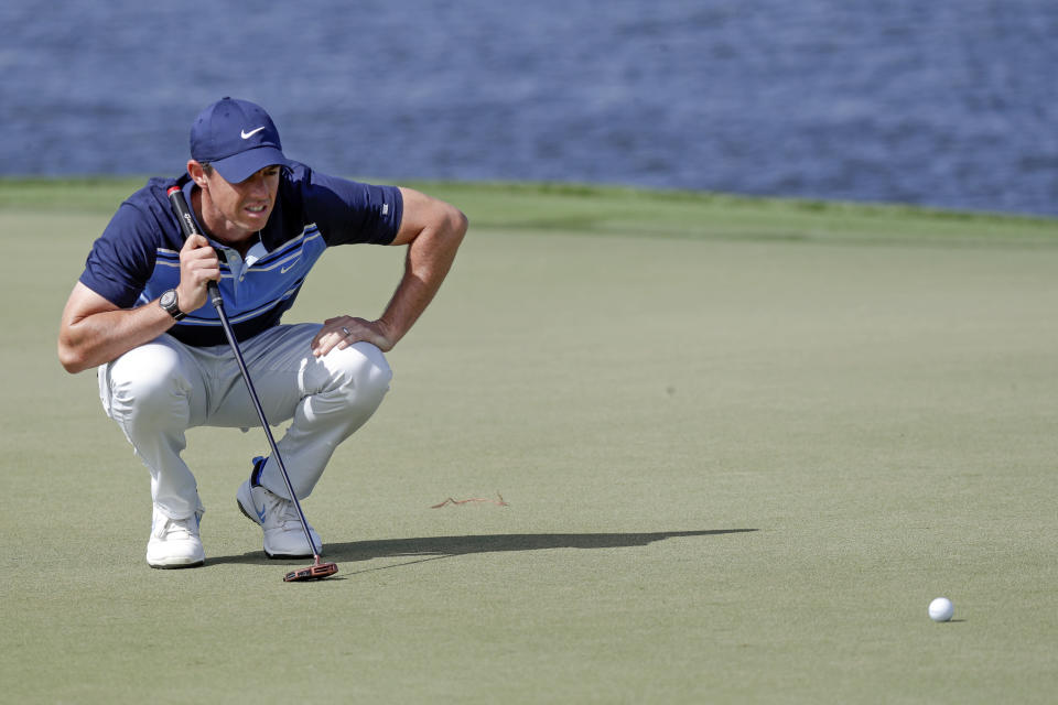 Rory McIlroy, of Northern Ireland, lines up a shot on the sixth green during the second round of the Arnold Palmer Invitational golf tournament Friday, March 6, 2020, in Orlando, Fla. (AP Photo/John Raoux)