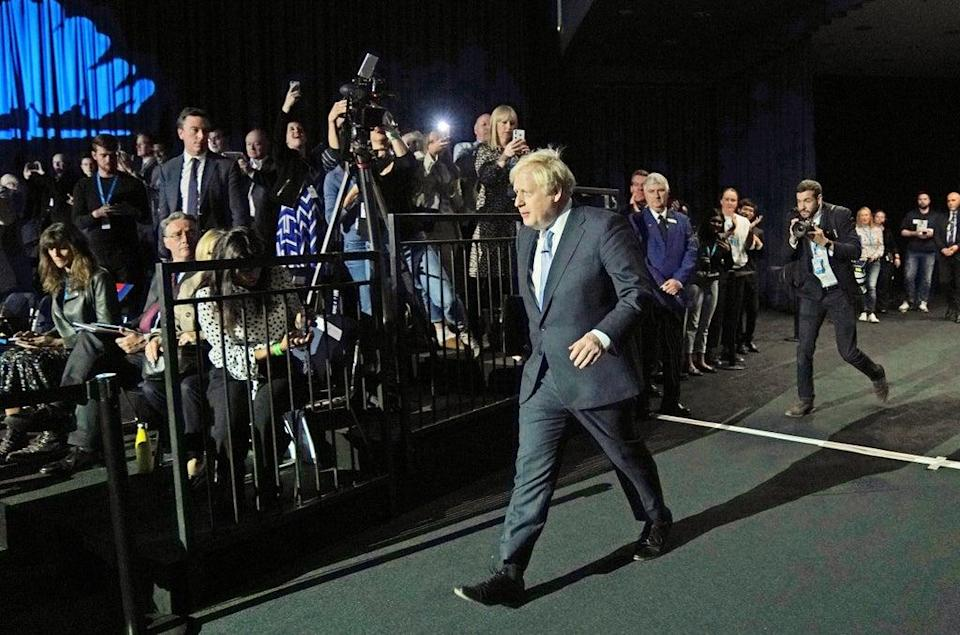 Prime Minister Boris Johnson arrives to deliver his keynote speech at the Conservative Party conference in Manchester (Jacob King/PA) (PA Wire)