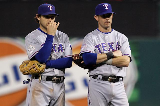 ST LOUIS, MO - OCTOBER 28: (L-R) Ian Kinsler #5 and Michael Young #10 of the Texas Rangers stand on the field during Game Seven of the MLB World Series against the St. Louis Cardinals at Busch Stadium on October 28, 2011 in St Louis, Missouri. (Photo by Ezra Shaw/Getty Images)