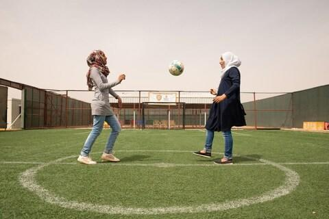 Sisters Rama, 15, and 18-year-old Hiba (right) take part in the Save the Children Coaching for Life programme in Jordan's Zaatari Syrian refugee camp - Credit: Save The Children