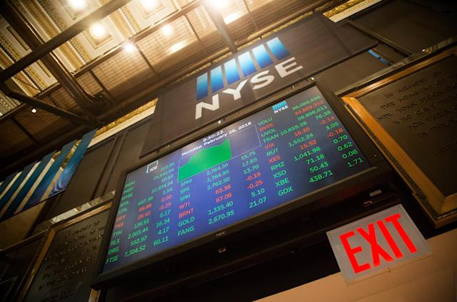 Stock market information is displayed on a monitor on the floor of the New York Stock Exchange (NYSE) in New York, U.S., on Monday, Feb. 26, 2018. U.S. stocks rose to a three-week high, as renewed gains in Treasuries that pushed yields further below 2.9 percent alleviated angst that higher rates would accelerate fiscal tightening. The dollar strengthened. Photographer: Michael Nagle/Bloomberg