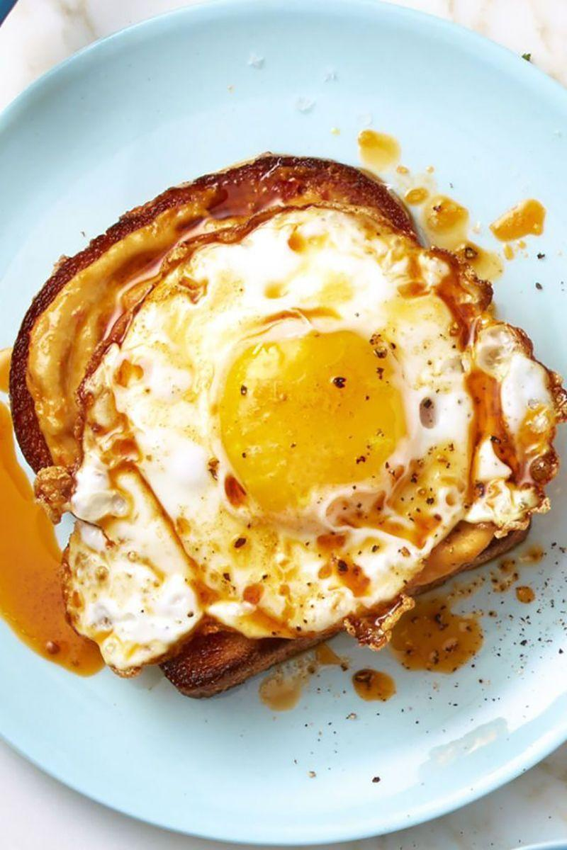 """<p>A nice runny egg paired with cheese and toast is breakfast perfection. Top with some some shallots if you're feeling extra fancy. </p><p><strong><em>Get the recipe at <a href=""""https://www.goodhousekeeping.com/food-recipes/a43252/smoky-red-pepper-crispy-egg-toast/"""" rel=""""nofollow noopener"""" target=""""_blank"""" data-ylk=""""slk:Good Housekeeping"""" class=""""link rapid-noclick-resp"""">Good Housekeeping</a>. </em></strong></p>"""
