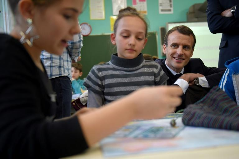 French President Emmanuel Macron during a visit to a primary school in Rilly-sur-Vienne, central France earlier this month. Macron wants to focus a efforts on improving early-age literacy