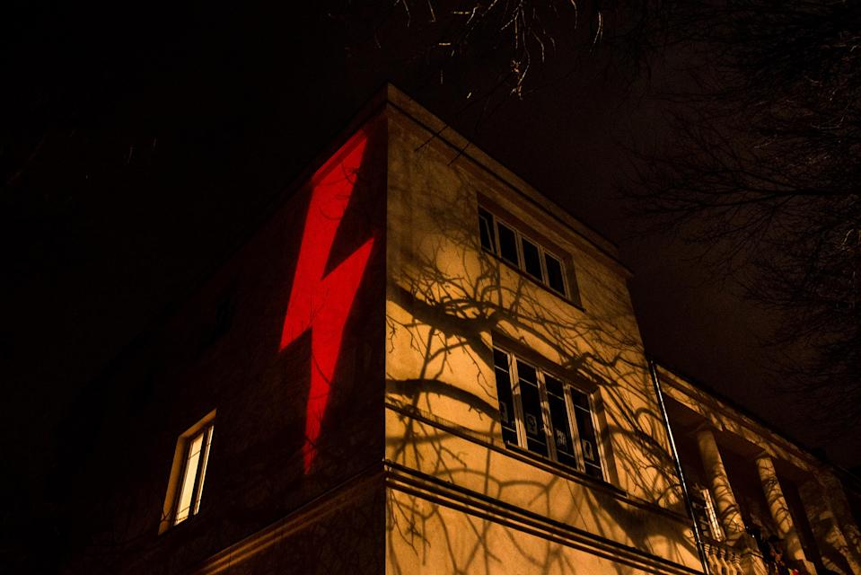 A red lightning bolt, the prominent symbol of recent protests against a Polish court's decision to effectively put a complete ban on abortion, is projected against a building in Warsaw on Oct. 30, 2020.