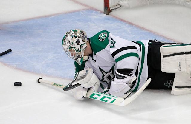 Dallas Stars goalie Kari Lehtonen, of Finland, looks at the puck after Anaheim Ducks' Andrew Cogliano scored against him during the third period in Game 2 of the first-round NHL hockey Stanley Cup playoff series on Friday, April 18, 2014, in Anaheim, Calif. The Ducks won 3-2. (AP Photo/Jae C. Hong)
