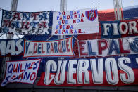 """A banner reads in Spanish """"There's no pandemic that can separate us,"""" placed by a San Lorenzo soccer fans inside the team's empty stadium minutes before the start of a game with Argentino Juniors amid COVID-19 pandemic restrictions keeping fans from stadiums in Buenos Aires, Argentina, Sunday, Aug. 22, 2021. Few places in the world have soccer fans more passionate than those in Argentina, and few have been so long denied a live view of their teams due to the pandemic. (AP Photo/Natacha Pisarenko)"""