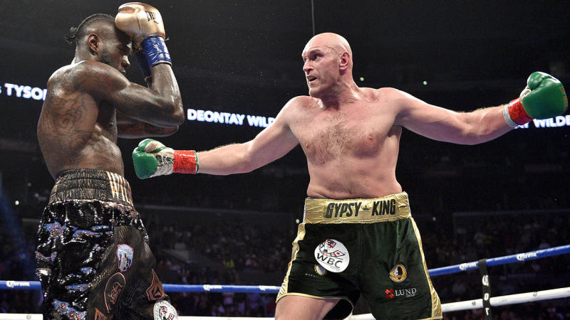 Tyson Fury toying with Deontay Wilder in the ring.