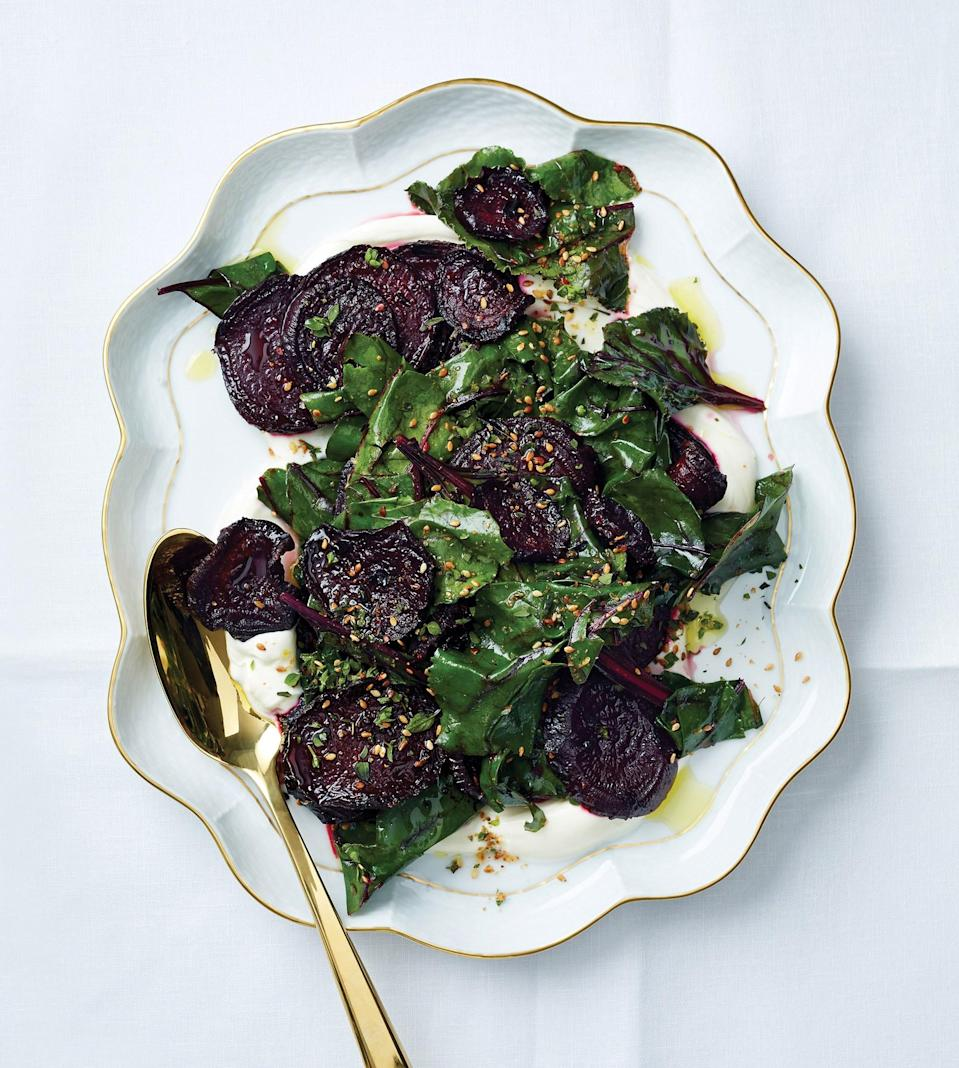 """Prettiest when not piled too high; divide the salad over two platters and put one at each end of the table. <a href=""""https://www.bonappetit.com/recipe/roasted-beets-with-sesame-and-marjoram?mbid=synd_yahoo_rss"""" rel=""""nofollow noopener"""" target=""""_blank"""" data-ylk=""""slk:See recipe."""" class=""""link rapid-noclick-resp"""">See recipe.</a>"""