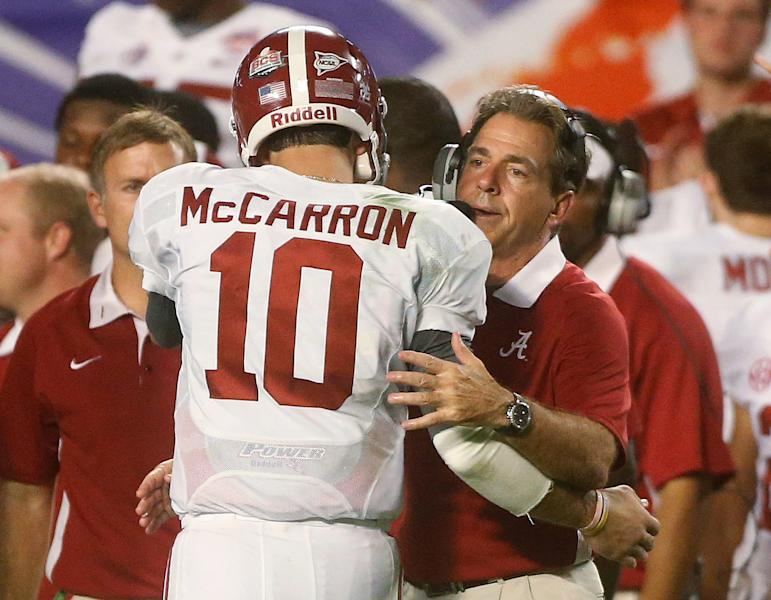 Alabama head coach Nick Saban hugs quarterback AJ McCarron in the final seconds of the BCS National Championship college football game against Notre Dame Monday, Jan. 7, 2013, in Miami. Alabama won 42-14. (AP Photo/John Bazemore)