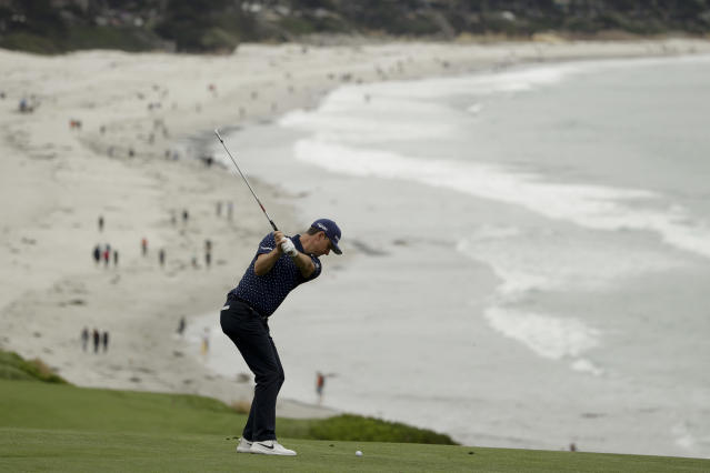 Justin Rose, of England, hits from the fairway on the ninth hole during the second round of the U.S. Open golf tournament Friday, June 14, 2019, in Pebble Beach, Calif. (AP Photo/Marcio Jose Sanchez)