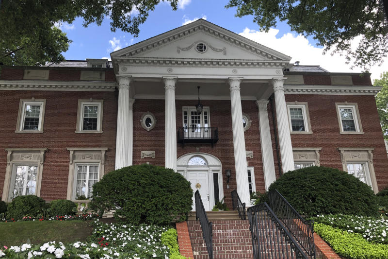 "This photo shows the West Virginia governor's mansion on Wednesday, Aug. 21, 2019, in Charleston, W.Va. A persistent lawsuit is drawing on the state constitution in an effort to force Republican Gov. Jim Justice to live at the governor's mansion. Democratic Del. Isaac Sponaugle filed the case and accuses Justice of violating a passage in the state Constitution that says the governor ""shall reside at the seat of government."" The result has been a long legal back and forth centered on the definition of the word reside. A judge requested more documents from both sides after a brief court hearing Wednesday. (AP Photo/Anthony Izaguirre)"