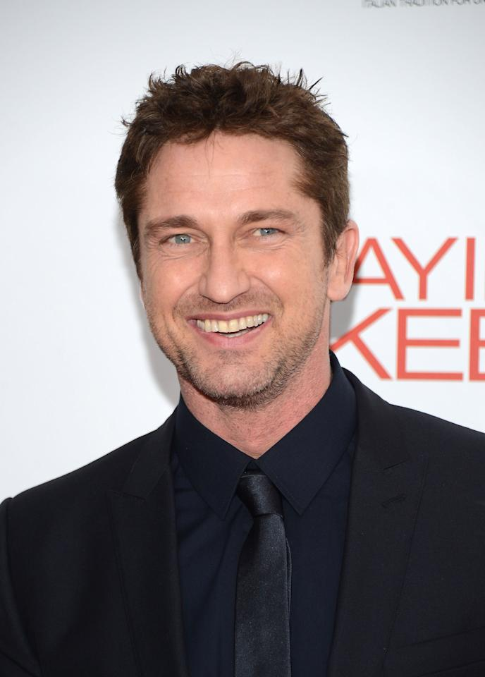 "NEW YORK, NY - DECEMBER 05:  Actor Gerard Butler attends Film District And Chrysler With The Cinema Society Premiere Of ""Playing For Keeps"" at AMC Lincoln Square Theater on December 5, 2012 in New York City.  (Photo by Andrew H. Walker/Getty Images)"