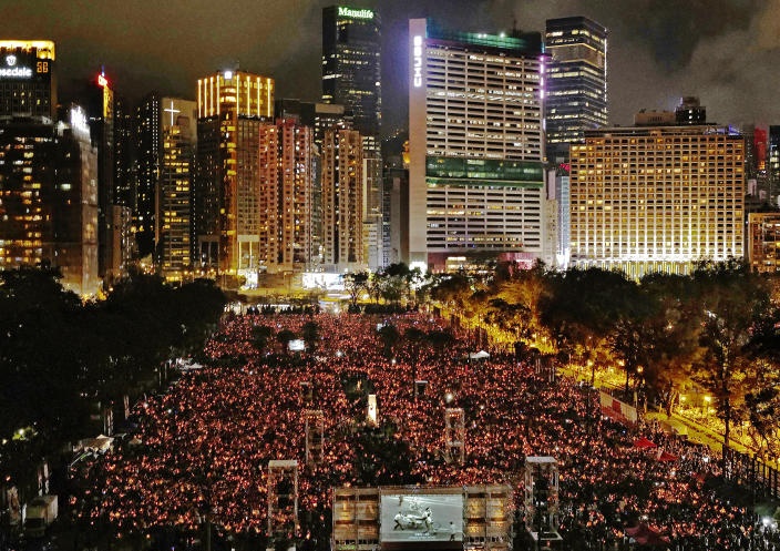 FILE-In this Tuesday, June 4, 2019, file photo, thousands of people attend a candlelight vigil for victims of the Chinese government's brutal military crackdown three decades ago on protesters in Beijing's Tiananmen Square at Victoria Park in Hong Kong. Hong Kong authorities for the second year have banned the June 4 candlelight vigil to commemorate the bloody crackdown on pro-democracy protests in Beijing's Tiananmen Square, organizers said Thursday, May 27, 2021. (AP Photo/Vincent Yu, File)