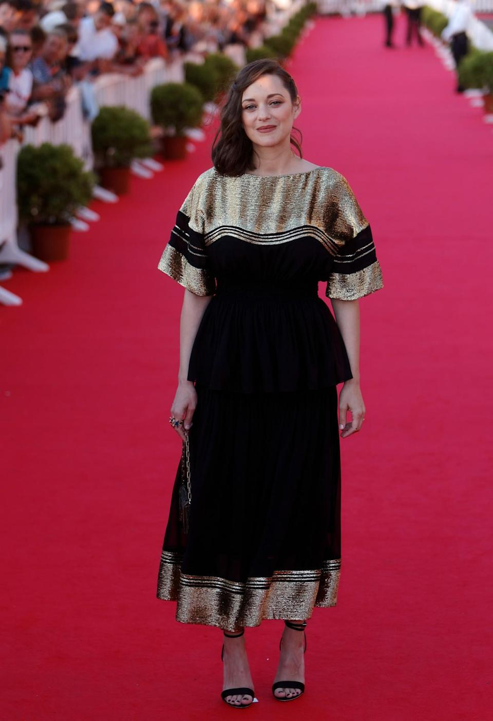 <p>The French film star opted for a black and gold Chloé gown for the event. <br><em>[Photo: Getty]</em> </p>