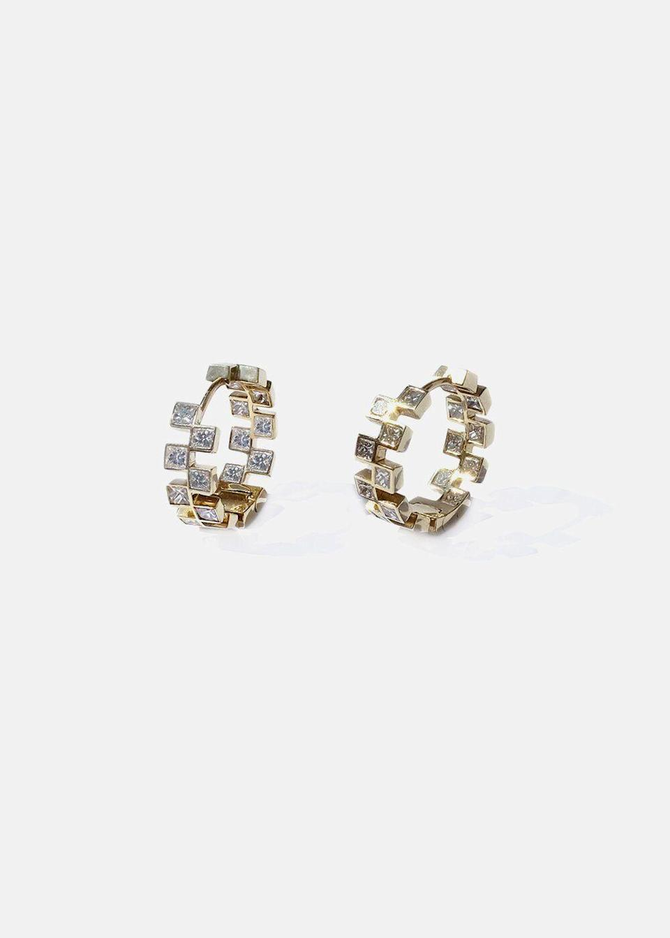"""<p><strong>KATKIM Fine Jewelry </strong></p><p>katkimfinejewelry.com</p><p><strong>$8600.00</strong></p><p><a href=""""https://katkimfinejewelry.com/collections/earrings/products/anerise-hoops"""" rel=""""nofollow noopener"""" target=""""_blank"""" data-ylk=""""slk:Shop Now"""" class=""""link rapid-noclick-resp"""">Shop Now</a></p><p>Crafted of 18-karat polished gold, these pieces feature invisible set princess-cut diamonds weighing 2.30 carats. They're a lovely modern update to her classic hoops. </p>"""