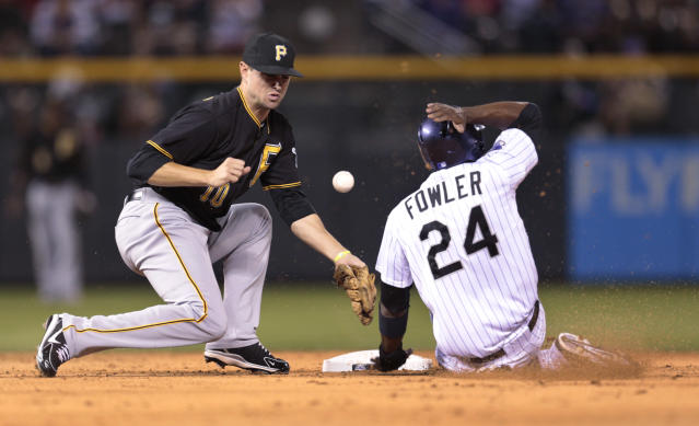 Colorado Rockies' Dexter Fowler (24) steals second base as the ball bounces away from PIttsburgh Pirates shortstop Jordy Mercer in the third inning of a baseball game in Denver, Saturday, Aug. 10, 2013. (AP Photo/Joe Mahoney)