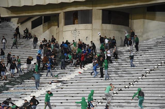Rival fans of Raja de Casablanca football club clash at the Mohammed V Stadium in Casablanca at the end of their match against Chabab Rif Al Hoceima on March 19, 2016 (AFP Photo/)