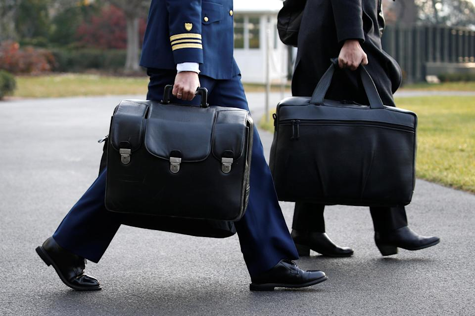 """A military aide carries the so-called """"nuclear football"""" (Reuters)"""