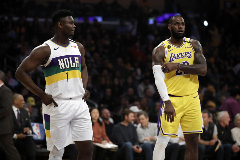 New Orleans Pelicans' Zion Williamson (1) stands next to Los Angeles Lakers' LeBron James during the first half of an NBA basketball game Tuesday, Feb. 25, 2020, in Los Angeles. (AP Photo/Marcio Jose Sanchez)