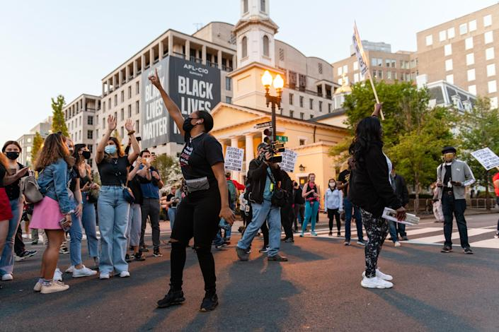 After the news of Derek Chauvin's guilty verdict in Minneapolis, people celebrate at Black Lives Matter Plaza in Washington, D.C., on April 20, 2021.