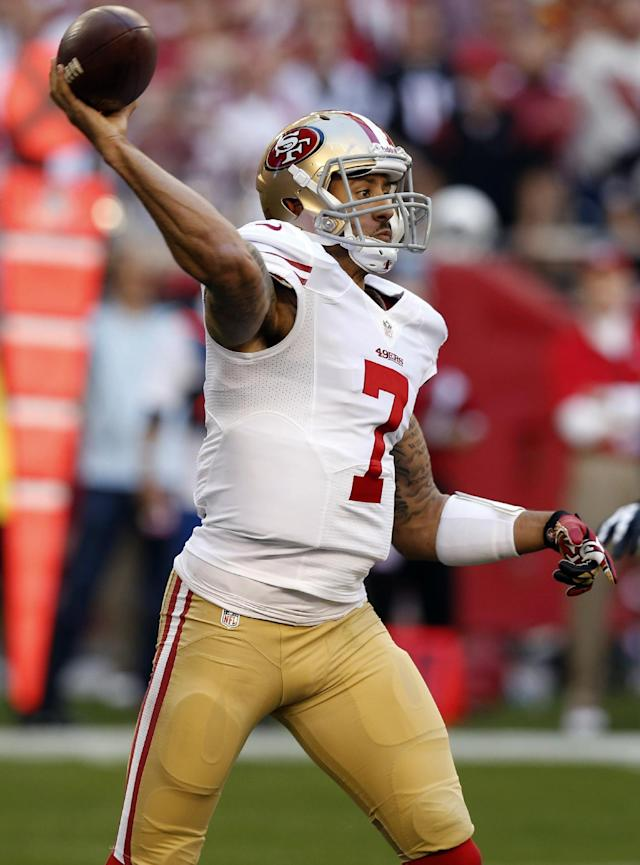 San Francisco 49ers quarterback Colin Kaepernick throws against the Arizona Cardinals during the first half of an NFL football game, Sunday, Dec. 29, 2013, in Glendale, Ariz. (AP Photo/Ross D. Franklin)