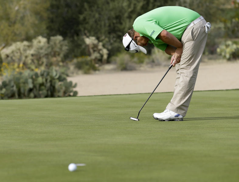 George Coetzee, of South Africa, reacts on the 17th hole, as he lost his third-round match against Jason Day, of the United States, at the Match Play Championship golf tournament Friday, Feb. 21, 2014, in Marana, Ariz. Day won 3 and 1. (AP Photo/Ted S. Warren)