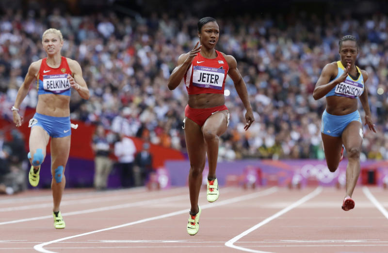 From left, Russia's Olga Belkina, United States' Carmelita Jeter and Bahamas' Sheniqua Ferguson go to cross the finish line in a women's 100-meter heat during the athletics in the Olympic Stadium at the 2012 Summer Olympics, London, Friday, Aug. 3, 2012. (AP Photo/Anja Niedringhaus)