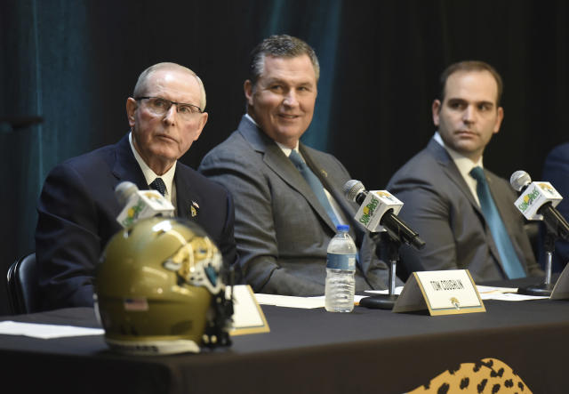 FILE - In this Jan. 12, 2017, file photo, From left, Tom Coughlin, Doug Marrone and general manager Dave Caldwell listen as Jacksonville Jaguars NFL football team owner Shad Khan speaks during a press conference at EverBank Stadium in Jacksonville, Fla. Khan gave two-year extensions to coach Marrone, executive vice president of football operations Coughlin and general manager Caldwell on Friday, Feb. 23, 2018. All three had two years remaining on their deals, which now will run through the 2021 season. (Bob Self/The Florida Times-Union via AP, File)