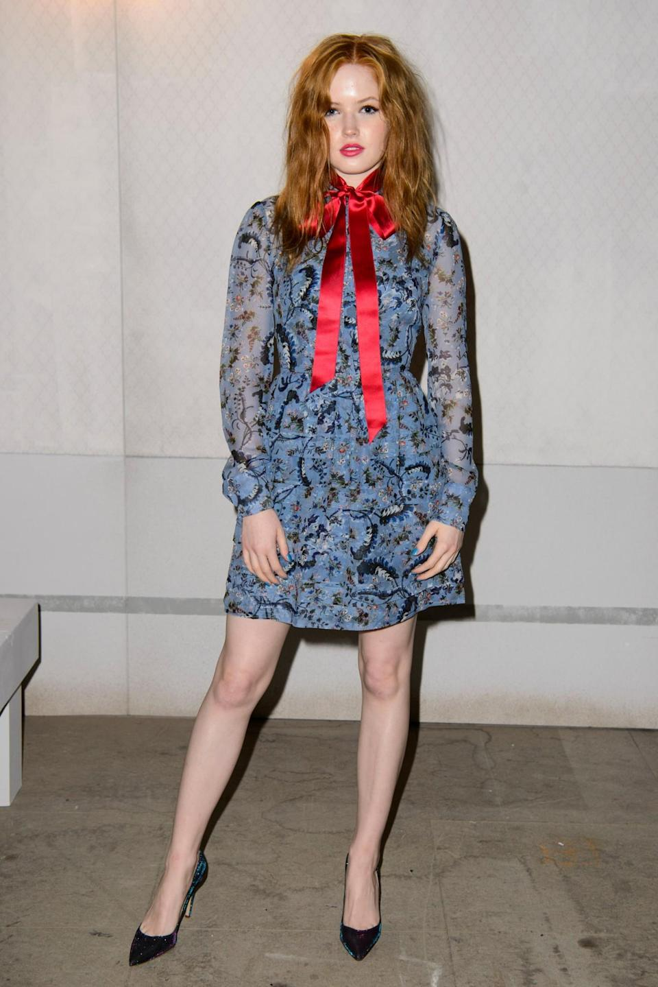 <p>Ellie Bamber chose a floral dress with a silk red bow. <i>[Photo: PA]</i> </p>
