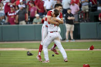 North Carolina State players Chris Villaman (left) and Tyler McDonough (right) celebrate after beating Arkansas 3-2 during an NCAA college baseball super regional game Sunday, June 13, 2021, in Fayetteville, Ark. (AP Photo/Michael Woods)