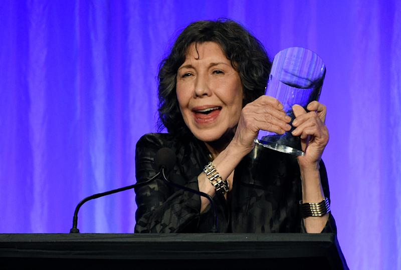"""Actress Lily Tomlin, whose credits include """"Rowan & Martin's Laugh-In,"""" '9 to 5' and 'Grace and Frankie,' shows off the well-deserved award she received at the Paley Honors TV comedy tribute on Thursday."""
