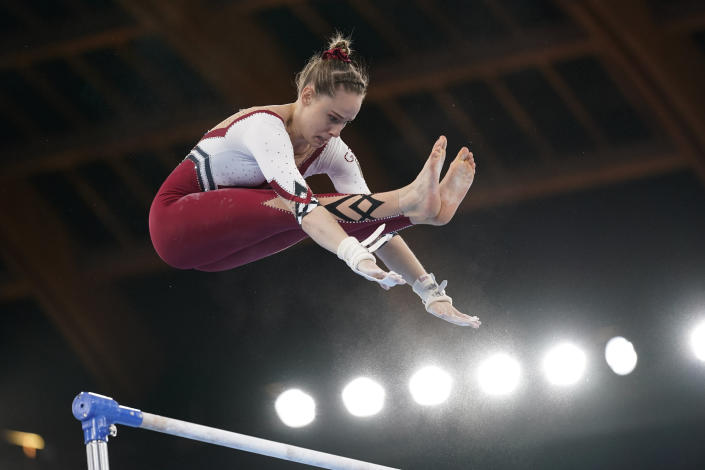 Sarah Voss, of Germany, performs on the uneven bars during the women's artistic gymnastic qualifications at the 2020 Summer Olympics, Sunday, July 25, 2021, in Tokyo. (AP Photo/Ashley Landis)