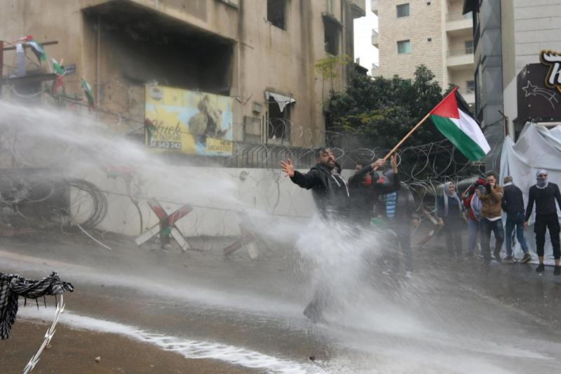 Lebanese security forces use a water hose to disperse protestors during a demonstration outside the US embassy (AFP/Getty Images)