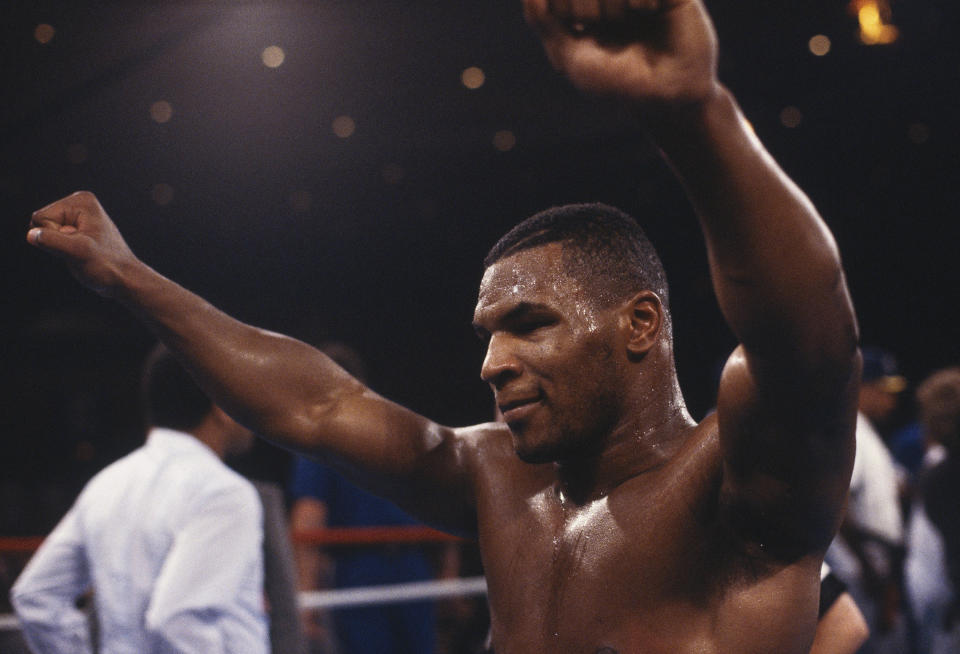 UNDATED: Mike Tyson raises his fists after winning  a bout. (Photo by Focus on Sport via Getty Images)
