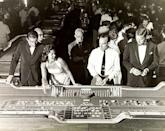 <p>A 1959 photoshoot at the Sands hotel around a casino craps table.</p>