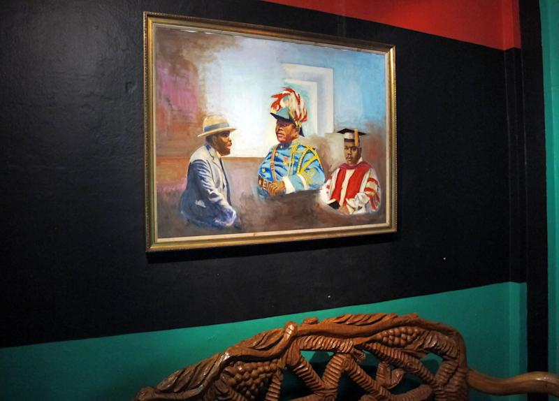 """In this Sept. 11, 2012 photograph, a painting of Marcus Garvey at different points of his life is seen at """"Liberty Hall"""", a museum and community center, in downtown Kingston, Jamaica. Jamaican students in every grade from kindergarten through high school have began studying the teachings of the 1920s-era black nationalist leader in a new mandatory civics program in schools across this predominantly black country of 2.8 million people. (AP Photo/David McFadden)"""
