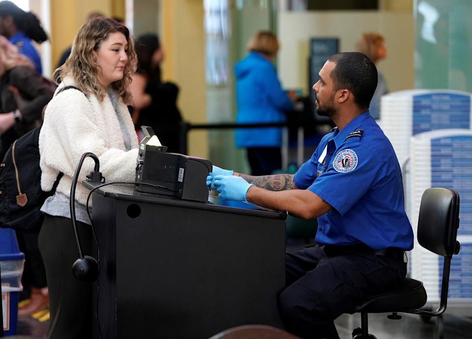 With more TSA workers calling out sick, travelers may face longer security lines. (Photo: REUTERS/Joshua Roberts)