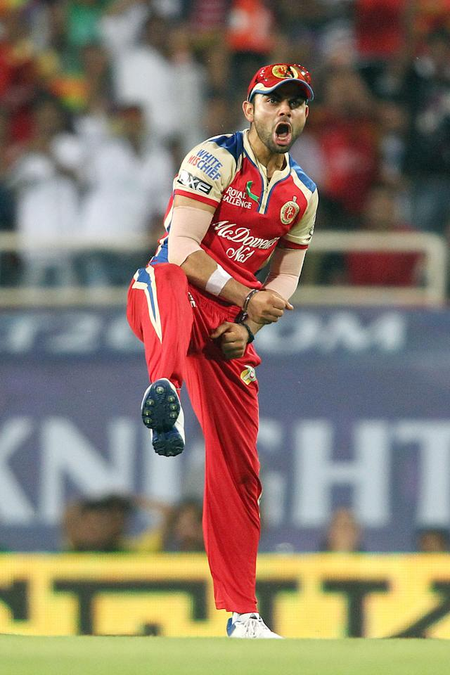 Royal Challengers Bangalore captain Virat Kohli celebrates after taking the catch to get Manoj Tiwary of Kolkata Knight Riders wicket during match 60 of the Pepsi Indian Premier League between The Kolkata Knight Riders and the Royal Challengers Bangalore held at the JSCA International Stadium Complex, Ranchi, India on the 12th May 2013. (BCCI)
