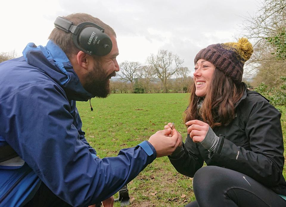 A man came up with an unusual way to propose by letting his girlfriend use a metal detector to find the ring [Photo: SWNS]