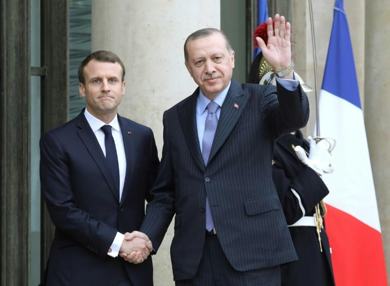 Happier times: French President Emmanuel Macron (L) greets his Turkish counterpart Recep Tayyip Erdogan ahead of luncheon at the Elysee palace in Paris in January 2018