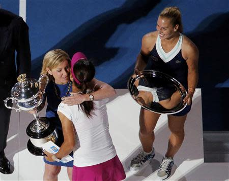 Tennis great Chris Evert (facing camera) of the U.S. hugs Li Na of China while presenting her with the Daphne Akhurst Memorial Cup after she won the women's singles final match against Dominika Cibulkova (R) of Slovakia at the Australian Open 2014 tennis tournament in Melbourne January 25, 2014. REUTERS/David Gray