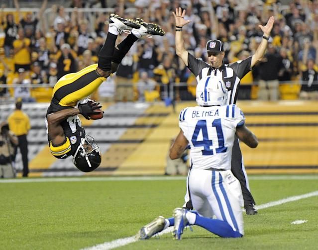 Pittsburgh Steelers wide receiver Antonio Brown (84), left, flips into the end zone over Indianapolis Colts defensive back Antoine Bethea (41) for a touchdown in the first quarter of an NFL football preseason game on Sunday, Aug. 19, 2012 in Pittsburgh. (AP Photo/Don Wright)