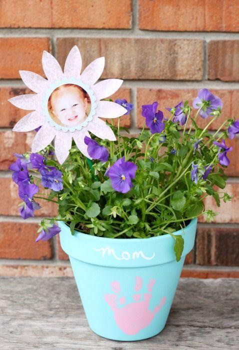 """<p>This craft gives Mom the best of both worlds—her favorite flowers and a photo of her favorite little human, all in a personalized pot. </p><p><strong>Get the tutorial at <a href=""""https://www.allthingsmamma.com/mothers-day-handprint-flower-pot/"""" rel=""""nofollow noopener"""" target=""""_blank"""" data-ylk=""""slk:All Things Mamma"""" class=""""link rapid-noclick-resp"""">All Things Mamma</a>. </strong></p><p><strong><a class=""""link rapid-noclick-resp"""" href=""""https://www.amazon.com/New-England-Pottery-Standard-Terra/dp/B01BLBSKXK/?tag=syn-yahoo-20&ascsubtag=%5Bartid%7C10050.g.4233%5Bsrc%7Cyahoo-us"""" rel=""""nofollow noopener"""" target=""""_blank"""" data-ylk=""""slk:SHOP POTS"""">SHOP POTS</a><br></strong></p>"""