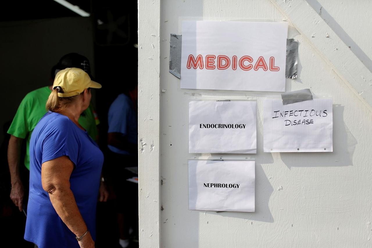 <p>A woman passes a sign at the medical clinic at the Remote Area Medical Clinic in Wise, Va., July 21, 2017. (Photo: Joshua Roberts/Reuters) </p>
