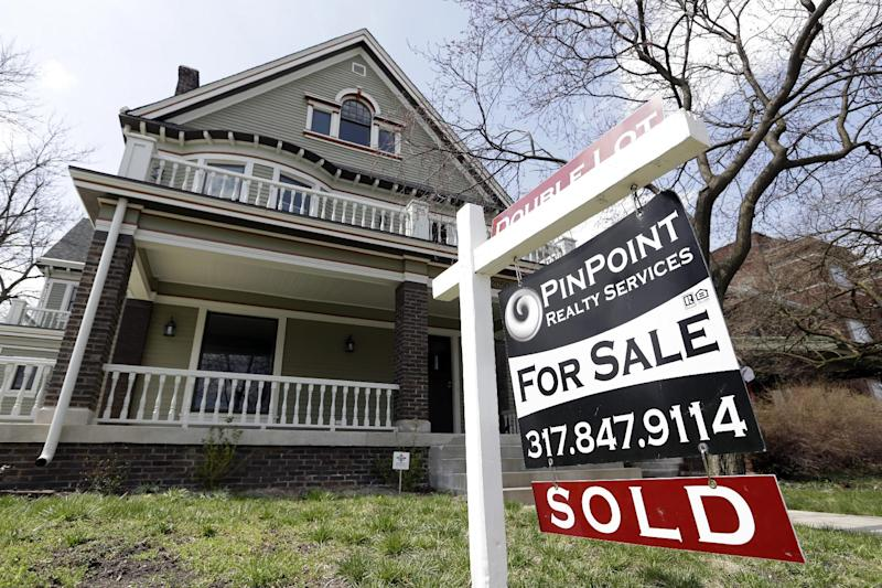 """In this Tuesday, April 9, 2013, photo, a """"Sold"""" sign is posted outside a home in Indianapolis. Mortgage giant Freddie Mac earned $4.6 billion from January through March of 2013, helped by a stronger housing market. The government-controlled company has turned a profit in the past six quarters.  (AP Photo/Michael Conroy)"""