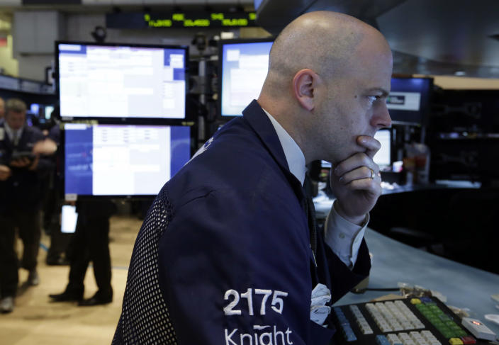 In this Tuesday, June 11, 2013, photo, specialist Christopher Carella works on the floor of the New York Stock Exchange. Global stock markets edged up Monday June 17, 2013 amid hopes that the U.S. Federal Reserve will put off plans to wind down its stimulus program. (AP Photo/Richard Drew)