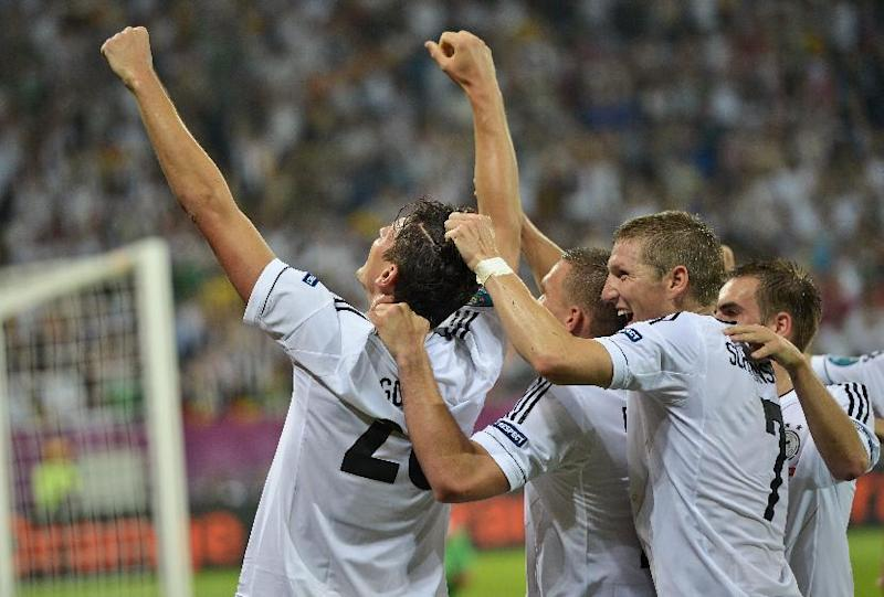 From the left, Germany's Mario Gomez, Lukas Podolski, Bastian Schweinsteiger and Philipp Lahm celebrate after they scored against Portugal during the Euro 2012 soccer championship Group B match between Germany and Portugal in Lviv, Ukraine, Saturday, June 9, 2012. (AP Photo/Martin Meissner)