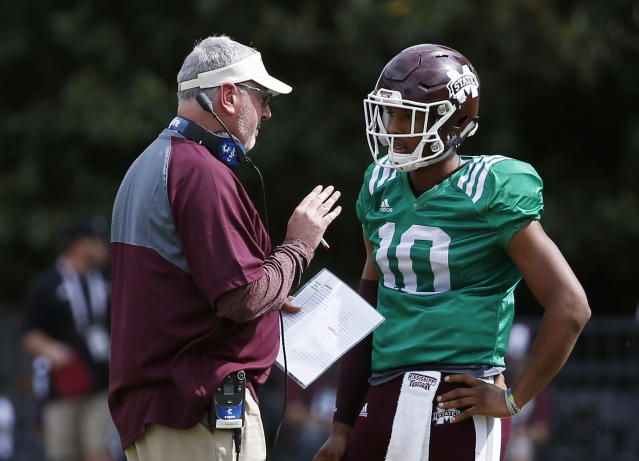 Maroon head coach Joe Moorhead, left, confers with Maroon quarterback Keytaon Thompson (10) during the first half of Mississippi State's Maroon and White spring NCAA college football game, Saturday, April 21, 2018, in Starkville, Miss. (AP Photo/Rogelio V. Solis)