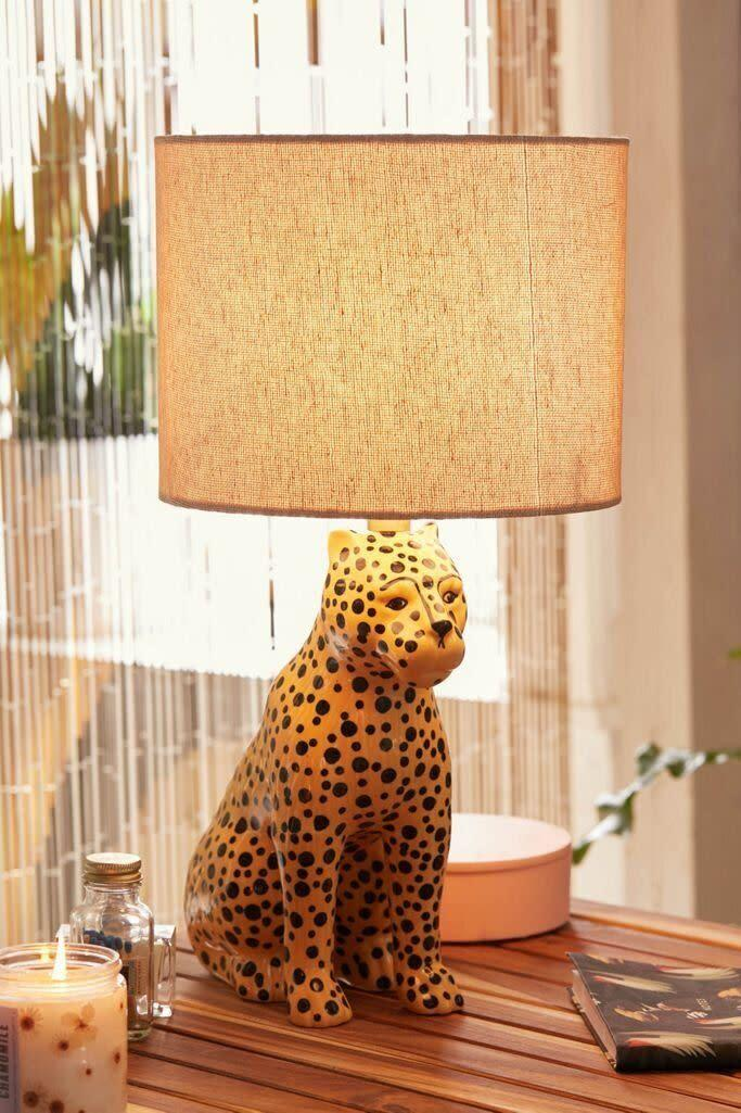 """If you're a fan of leopard print, you just might go for this leopard lamp, which features a ceramic base and a woven shade. You'll have to get a <a href=""""https://fave.co/3iyjiJL"""" rel=""""nofollow noopener"""" target=""""_blank"""" data-ylk=""""slk:60-watt bulb"""" class=""""link rapid-noclick-resp"""">60-watt bulb</a> since one isn't included. And it plugs in to power on. <a href=""""https://fave.co/3hA6OjH"""" rel=""""nofollow noopener"""" target=""""_blank"""" data-ylk=""""slk:Find it for $99 at Urban Outfitters"""" class=""""link rapid-noclick-resp"""">Find it for $99 at Urban Outfitters</a>."""